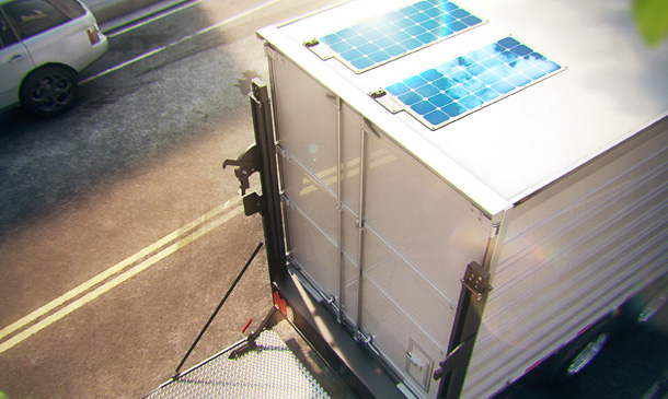 Photo of solar panels on the back of a trailer.