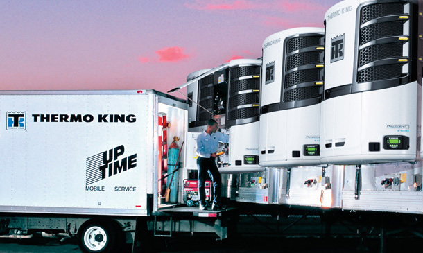 Photo of UpTime mobile service truck near a row of trailers with Precedent units.