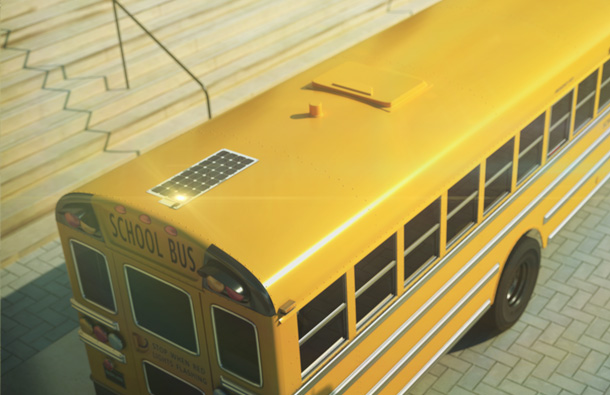 Photo showing a School Bus with a solar panel