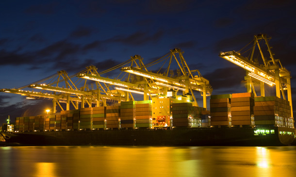 Photo of a container port at night time